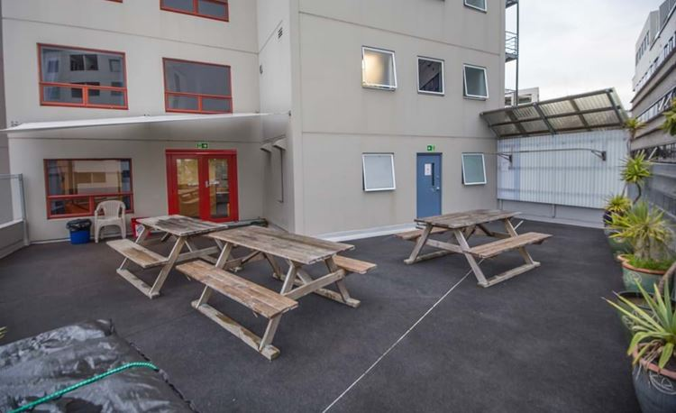 YHA Auckland City outdoor social area with picnic tables