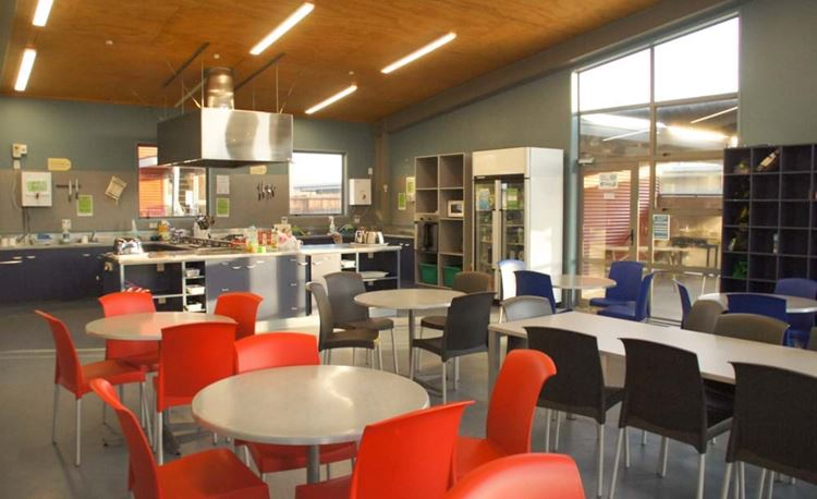 YHA Rotorua dining area mess hall with communal kitchen area