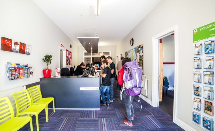 YHA Christchurch youth travelers checking into reception area