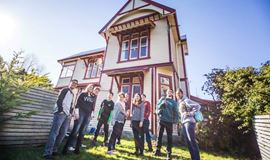 YHA Christchurch Rolleston House outdoor front yard with youth travelers
