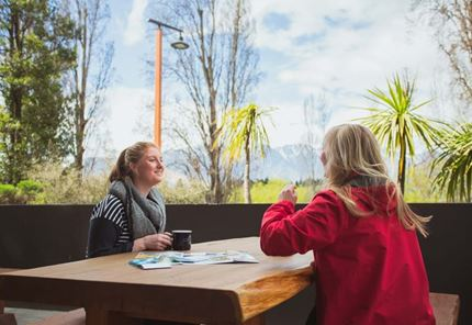 YHA Queenstown Lakefront youth travelers planning in outdoor deck area