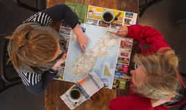 YHA Queenstown Lakefront youth travelers planning with map