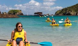 YHA Bay of Islands the Rock youth travelers forming a kayak pack from cruise