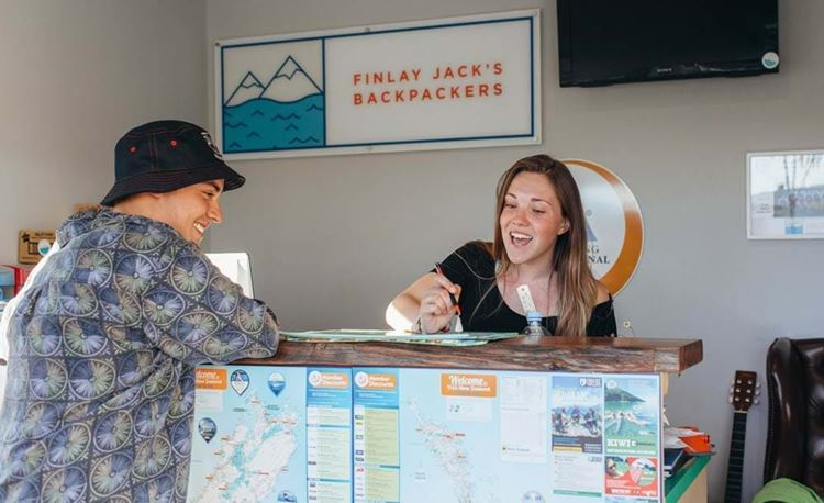 YHA Taupo youth traveler checking into reception