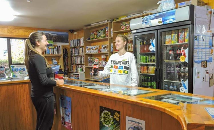 YHA National Park youth traveler buying a cola from reception