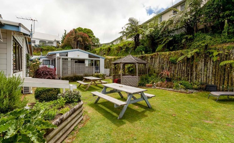 YHA New Plymouth outdoor area garden with picnic tables