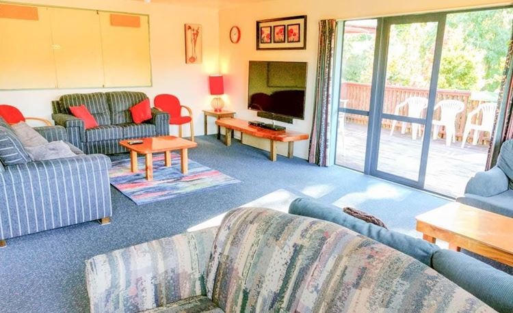 YHA Hanmer Springs lounge area with access to deck