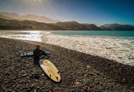 yha Kaikoura surfer looking for waves to catch