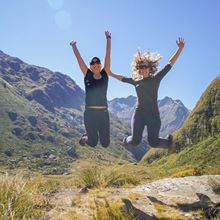 YHA Te Anau travellers jumping for joy on routeburn track