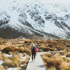 YHA Aoraki Mt Cook travellers heading over wetlands