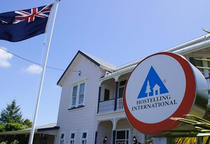 YHA Whanganui yha logo with new zealand flag