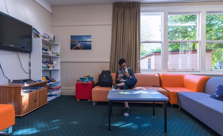 Guest chills in Christchurch Rolleston House's lounge