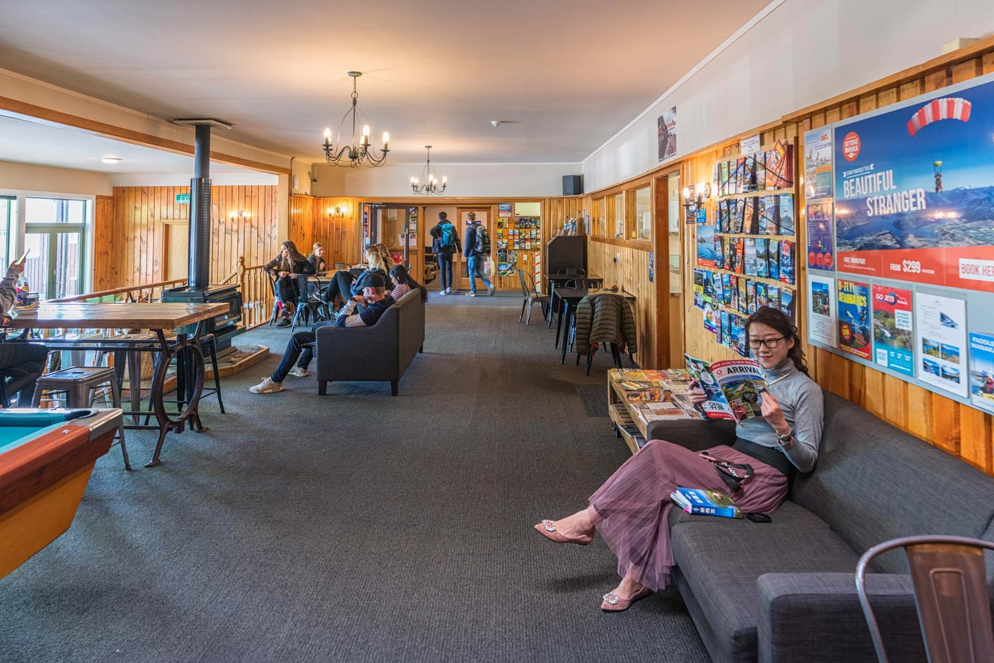 Guests chill in YHA Wanaka's lounge