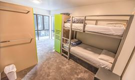 YHA Queenstown Lakefront multishare dormitory-style bedroom with bunk beds