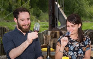 Appellation Wine Tours Queenstown - couple tasting wine