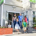 Family walking out of YHA Christchurch
