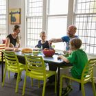Family eating in shared dining rom at YHA Christchurch